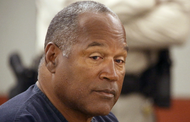 O.J. Simpson appears at Clark County Regional Justice Center on Monday. Simpson, 65,  former Hall of Fame football player and celebrity, is requesting a retrial from the 2008 Las Vegas trial that  ...
