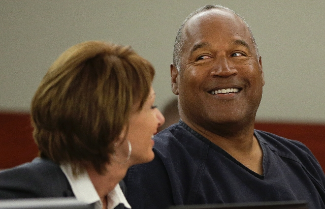 O.J. Simpson, right, talks with his attorney, Patricia Palm in Clark County District Court on Monday. Simpson, who is currently serving a nine-to-33-year sentence in state prison as a result of hi ...