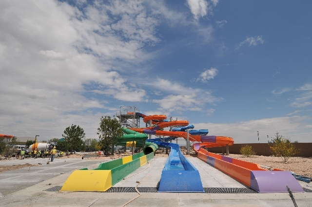 A construction crew works May 8 to finish the Wet 'n' Wild water park, 7055 S. Fort Apache Road, in advance of its scheduled May 25 opening. The 41-acre facility has more than 25 rides, including  ...