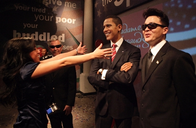 Roxana Sanchez, left, readies to hug a wax figure of President Barack Obama at Madame Tussauds at The Venetian. The museum will raise its prices at the end of the month.