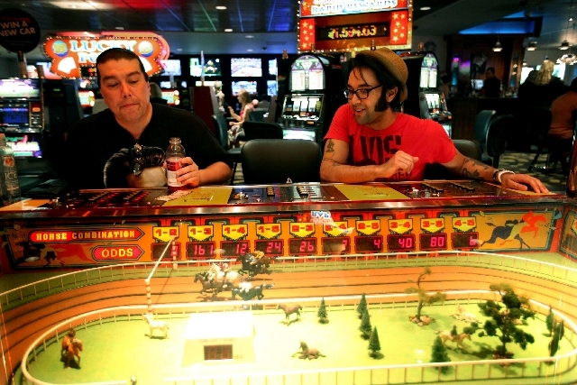 Brian Simpson, left, and Eli Williams, both of Vancouver, British Columbia, play the Sigma Derby game at the D Las Vegas on May 13. After $22 million in renovations, the former Fitzgeralds in down ...
