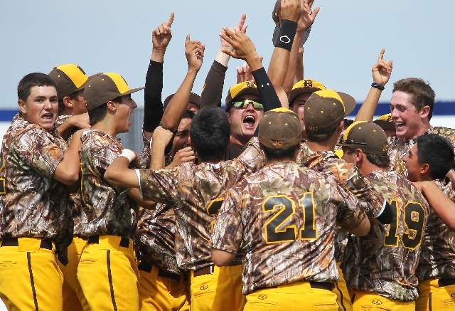 Bonanza head coach Derek Stafford, center in the sunglasses, celebrates with his players after their come-from-behind win over Bishop Gorman in the Sunset Region championship.