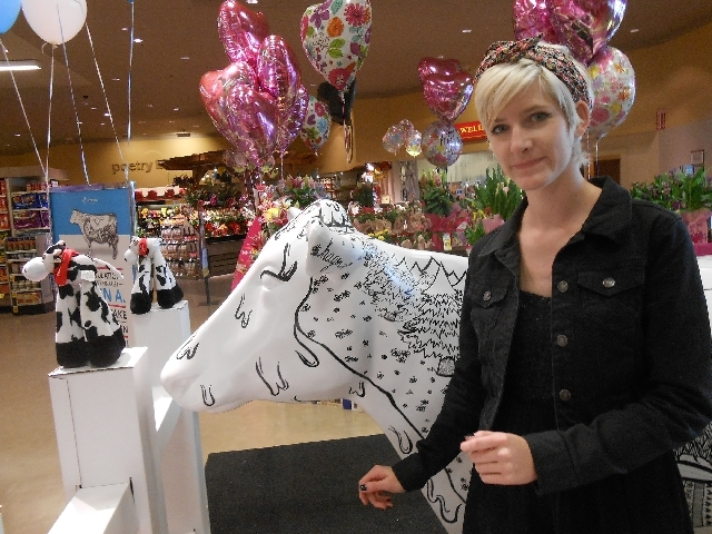 Hagen Anderson, a Northwest Career and Technical Academy student and Summerlin resident, checks out her painted cow May 9 at a promotional display at Vons, 7530 W. Lake Mead Blvd. Anderson, 18, wa ...
