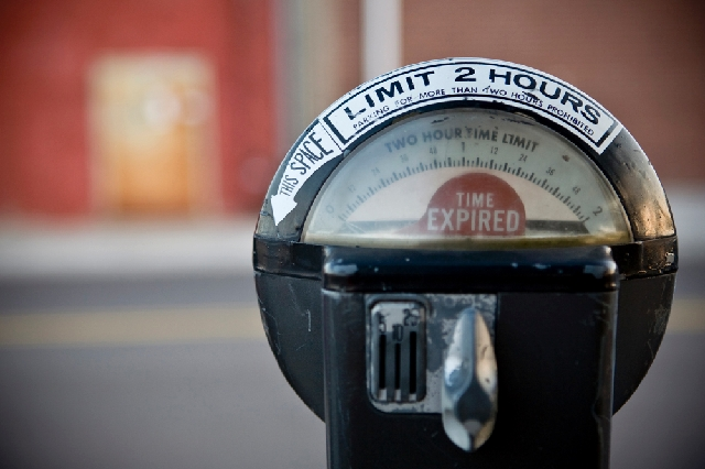A group that feeds change into parking meters about to expire has been sued by the city. The lawsuit asks the group to stay at least 50 feet away.