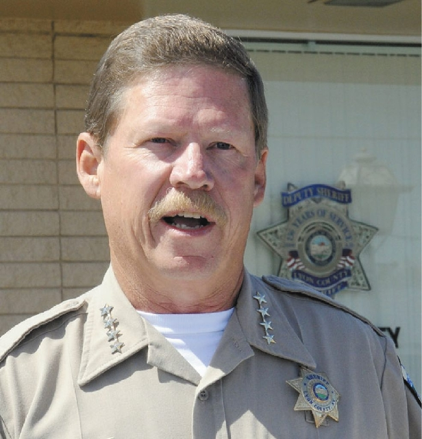 Lyon County Sheriff Allen Veil addresses the media Tuesday regarding the four deaths that occurred in that county on Monday. A fifth body was found in Washoe County at Interstate 80 and the Mustan ...