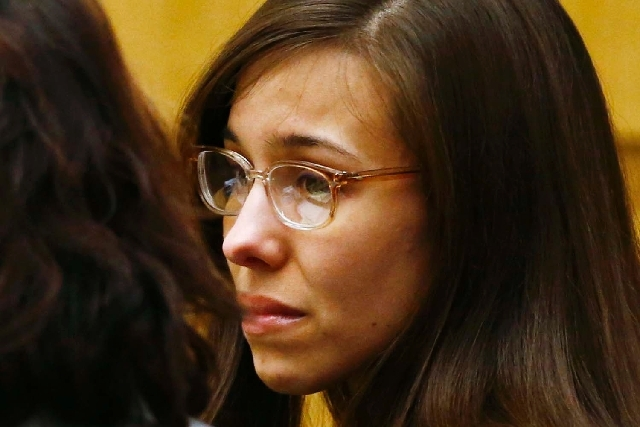 Jodi Arias reacts at Maricopa County Superior Court in Phoenix on May 8 after she was found of guilty of first-degree murder in the gruesome killing of her one-time boyfriend, Travis Alexander, in ...