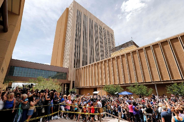 Spectators wait outside Superior Court in Phoenix on May 8 for a verdict in the trial of Jodi Arias, a waitress and aspiring photographer charged with killing her boyfriend, Travis Alexander, in A ...