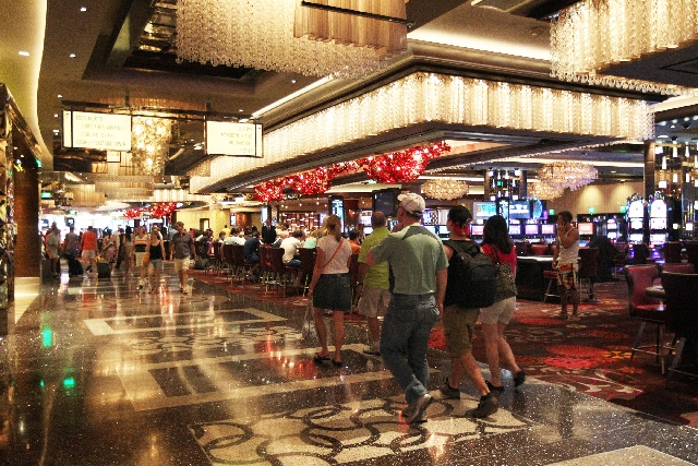 Patrons take advantage of the gaming areas at the Cosmopolitan hotel-casino on the Las Vegas Strip on Wednesday.