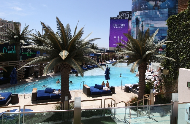 Patrons lounge by the pool at the Cosmopolitan hotel-casino on the Las Vegas Strip on Wednesday.