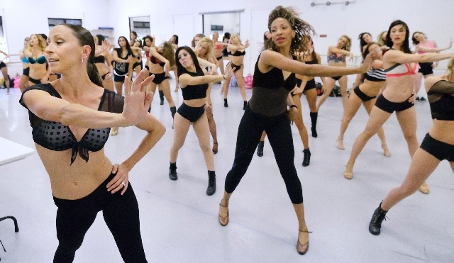 "Anna Cooke, line captain for ""Sirens of TI,"" left, leads potential future cast members through a dance routine May 14 during a casting call at Backstage Dance Studios.  ""Sirens,"" one of a dwindlin ..."