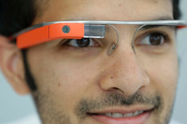 Google Glass team member Salil Pandit wears Google Glasses at a booth at Google I/O 2013 in San Francisco on Wednesday.