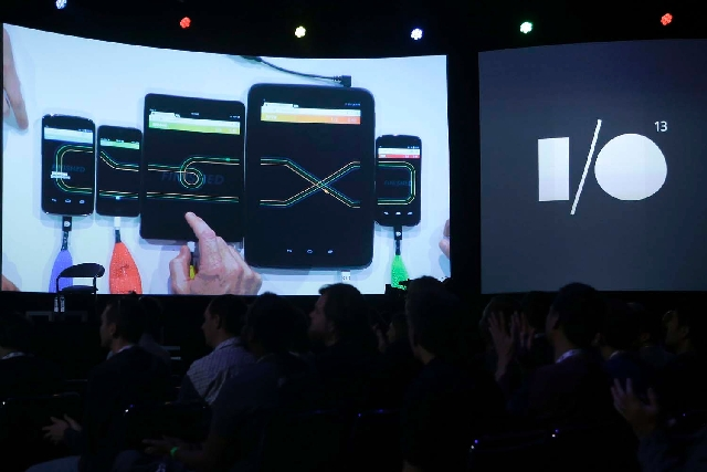 The Google Racer game is seen being played on different devices on a screen during the keynote presentation at Google I/O 2013 in San Francisco on Wednesday.