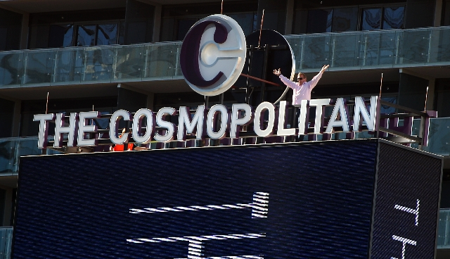 John Unwin, CEO of The Cosmopolitan, Las Vegas, stands atop its signature marquee as it was lit up Tuesday August 3, 2010.