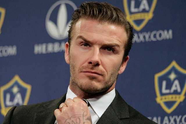 David Beckham, shown here in January 2012, says he is retiring from soccer at the end of the season. The 38-year-old Beckham recently won a league title in a fourth country with Paris Saint-Germain.