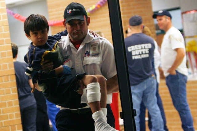 A young injured boy is carried to an awaiting ambulance Wednesday in Granbury, Texas.  A rash of tornadoes slammed into several small communities in North Texas overnight, leaving at least six peo ...