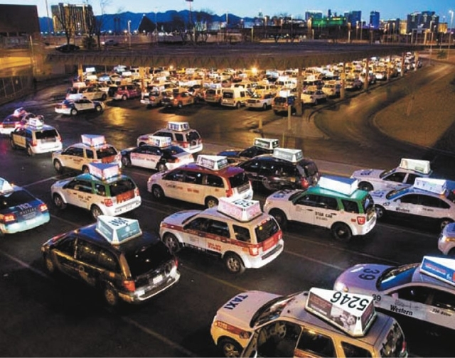 Taxis wait to pick up passengers March 1 at McCarran International Airport. A Legislative Counsel Bureau audit report published in April recommended an overhaul for how medallions, the operating p ...