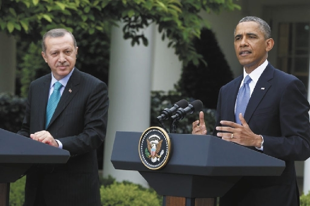 President Barack Obama, accompanied by Turkish Prime Minister Recep Tayyip Erdogan, left, speaks during their joint news conference Thursday in the Rose Garden of the White House.