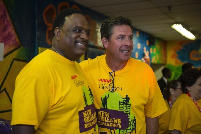 Sports commentator James Brown, left, stands with Hall of Fame quarterback Dan Marino. Both are ambassadors for AARP and will appear at the upcoming convention.