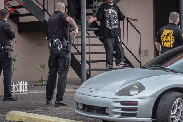 Albuquerque police officers search for a suspect who apparently kidnapped a 4 year old near Near Indian School on Wednesday.  The mother of the kidnapped victim chased the kidnapper to Southeast A ...