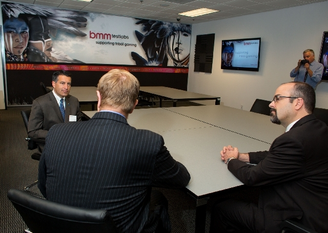 From left, Gov. Brian Sandoval, Chief Operating Officer Mike Dreitzer (cq) and Vice President Operations Travis Foley with BMM talk during Sandoval's tour of the gaming lab at 815 Pilot Road, suit ...