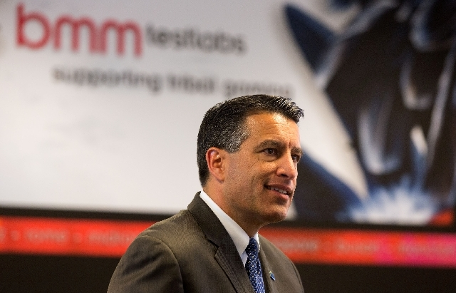 Gov. Brian Sandoval tours the BMM gaming lab at 815 Pilot Road, suite G on Thursday.