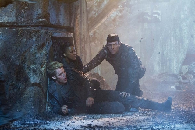 "This undated publicity film image released by Paramount Pictures shows Chris Pine as Kirk, Zoe Saldana as Uhura and Zachary Quinto as Spock in a scene from the movie, ""Star Trek Into Darkness,"" fr ..."