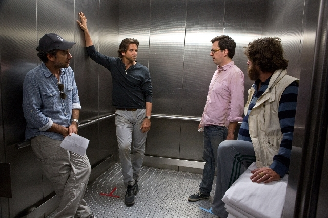 """From left, director Todd Phillips, Bradley Cooper, Ed Helms and Zach Galifianakis are shown on the set of """"The Hangover Part III."""""""