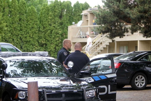 Police stand watch as federal authorities search an apartment in Boise, Idaho on Thursday afternoon.