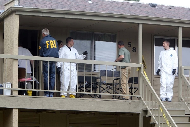 Federal authorities search an apartment in Boise, Idaho on Thursday afternoon. U.S. authorities said they have arrested a man from Uzbekistan accused of conspiring with a designated terrorist orga ...