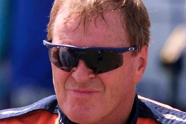 In this June 4, 1999, file photo, NASCAR driver Dick Trickle speaks to fans after qualifying on the pole position the NASCAR Busch series auto race at Dover Downs in Dover, Del. Authorities in Nor ...