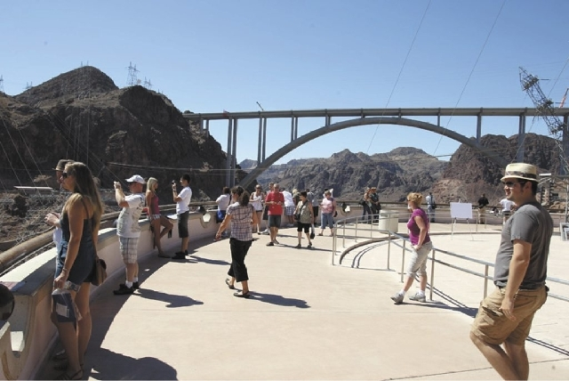 Visitors get a view of the  Hoover Dam Bypass Bridge and Hoover Dam from the visitors center.