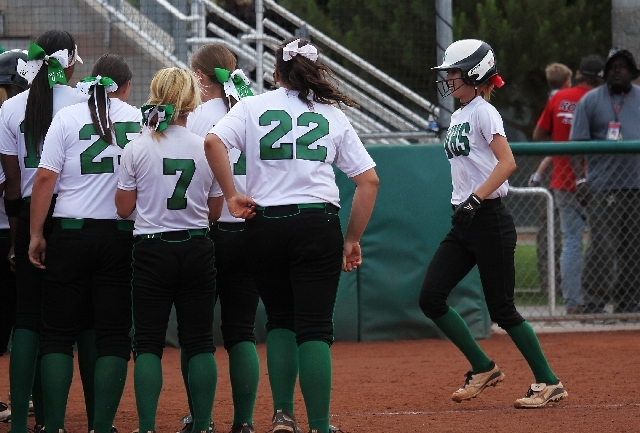 Palo Verde players line up to welcome Brooke Stover, right, at home plate after her tiebreaking home run leading off the sixth inning against Green Valley in the first round of the Division I soft ...