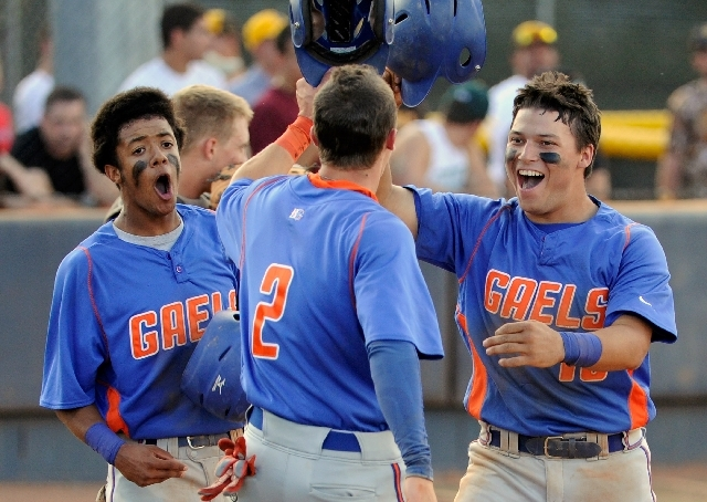 Bishop Gorman's Michael Blasko, right, is greeted by teammates Cadyn Grenier (2) and Willie Jumper after hitting a three-run homer during the second inning against Coronado in the Division I state ...