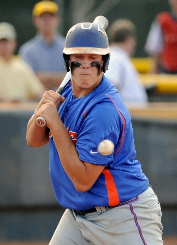 Bishop Gorman's Nick Gates is hit on the arm by a pitch during the Gaels' 9-7 win over Coronado in the Division I baseball state tournament Thursday.