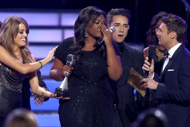 "Runner-up Kree Harrison, from left, Angie Miller, winner Candice Glover, Lazaro Arbos and host Ryan Seacrest react after Glover is announced the winner at the ""American Idol"" finale at the Nokia T ..."