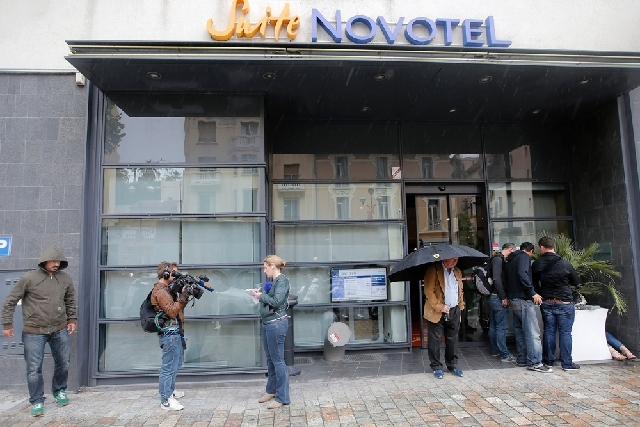 Reporters gather outside the Novotel hotel during the 66th international film festival, in Cannes, southern France, on Friday. A French police official says a thief or thieves stole about $1 milli ...