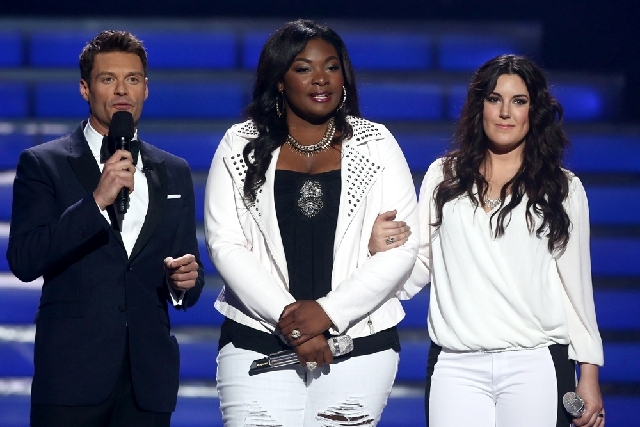 """Host Ryan Seacrest, left, and finalists Candice Glover, center, and Kree Harrison speak on stage at the """"American Idol"""" finale at the Nokia Theatre at L.A. Live on Thursday. Ratings for the final  ..."""