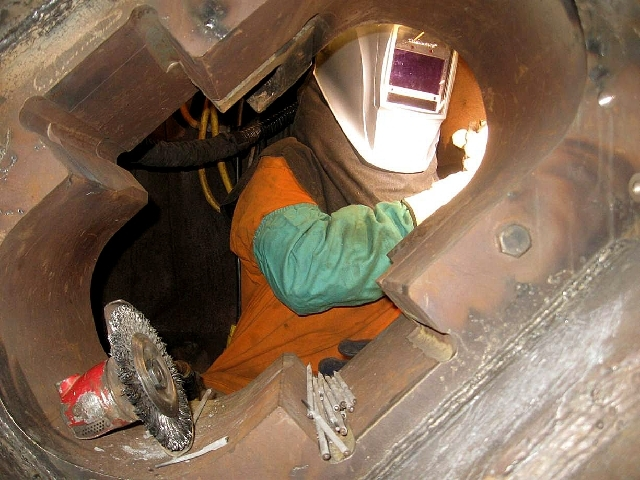 A worker welds the box for cutter no. 9 into the cutter head of the tunnel boring machine used by the Southern Nevada Water Authority to drill the third intake access shaft at Lake Mead in a photo ...