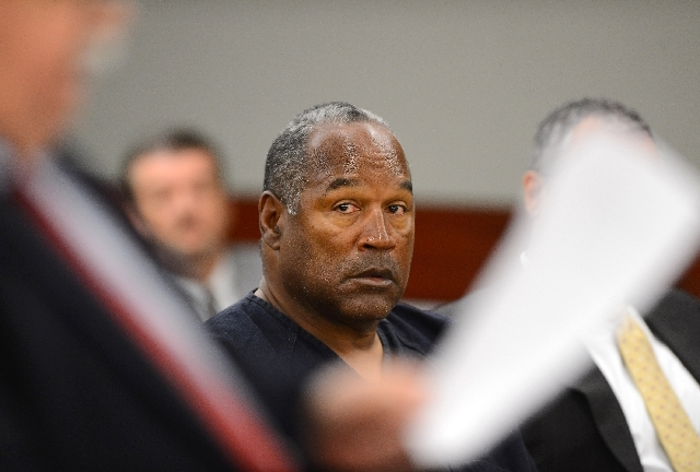 O.J Simpson looks over at his lawyer Tom Pitaro during an evidentiary hearing in Clark County District Court on May 17 in Las Vegas.