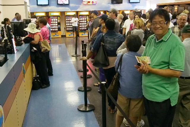 Robert Constantion, of Las Vegas, right, is almost at the ticket counter after a nearly four-hour wait at the Lotto Store just inside the California border at Primm, Friday, May 17, 2013. The Powe ...