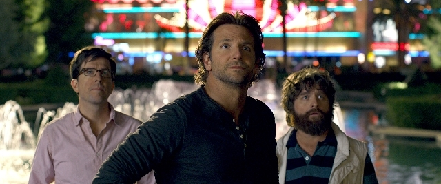 """Three members of the Wolf Pack, from left, Ed Helms as Stu, Bradley Cooper as Phil and Zach Galifianakis as Alan, appear in this scene shot on the Strip in """"The Hangover Part III."""""""