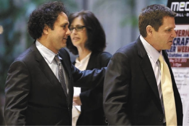 Sacramento Kings owners George Maloof, left, and his brother Joe, right, leave the NBA Board of Governors meeting on Wednesday in Dallas. NBA owners voted Wednesday to reject the Kings' proposed m ...