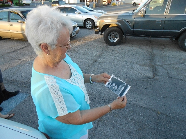 Connie Sheldon displays a photo from 1961 showing her and a co-worker in front of the Huntridge Theatre. Sheldon worked as an usher and cashier at the historic movie theater from 1960 until 1968.