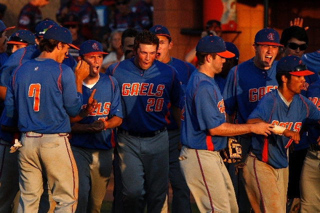 Bishop Gorman baseball players celebrate after beating Bonanza 10-1 in a Division I state semifinal Friday at College of Southern Nevada. The Gaels play Coronado for the title today.