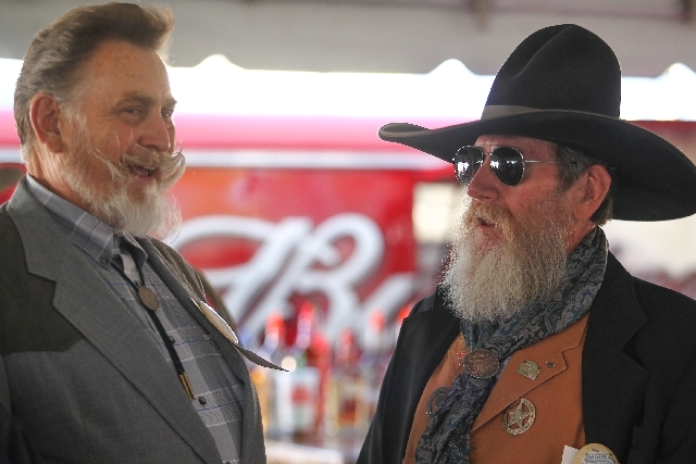Rick Dahl, left, and Cactus McHarg talk before participating in the Whiskerino contest that dates back to 1934 at Helldorado Days.