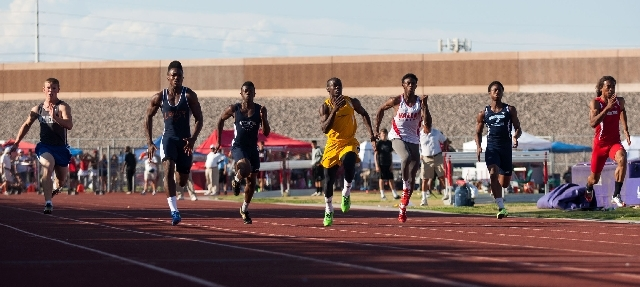 Bonanza junior Jayveon Taylor, center in yellow, takes the lead in the Division I 100-meter dash Friday during the state track and field championships at Silverado. Taylor outleaned Legacy's Casey ...