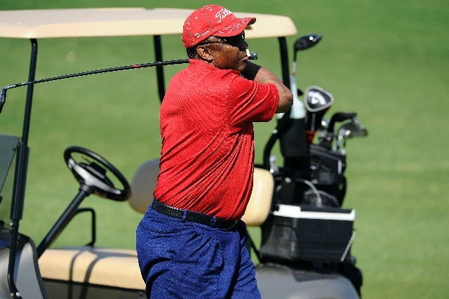 1972 Heisman Trophy winner Johnny Rodgers tees off during the Level Playing Field Foundation golf fundraiser at Palm Valley Golf Course in Las Vegas on Saturday.