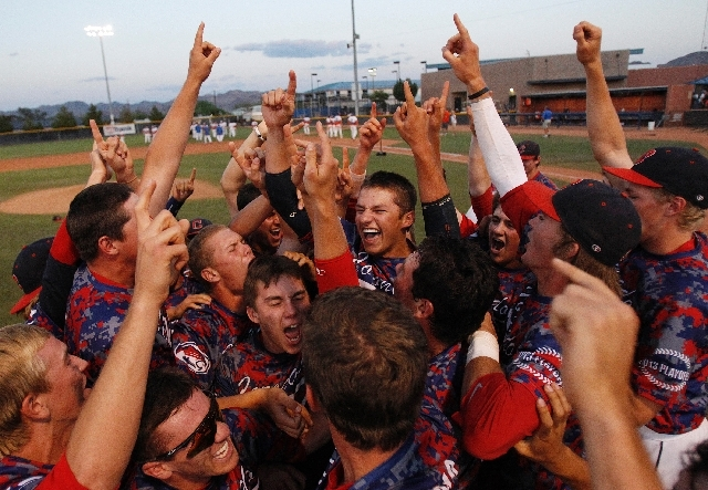 The Coronado High School baseball team celebrates after defeating Bishop Gorman High School in the state baseball championship game Saturday in Henderson.