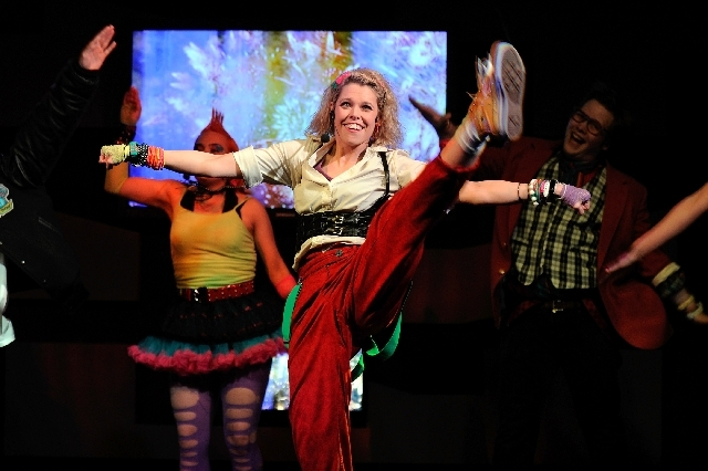 "Kim Wood performs with the other cast members in ""The 80s Show"" at the V Theater inside the Miracle Mile Shops at Planet Hollywood Resort."
