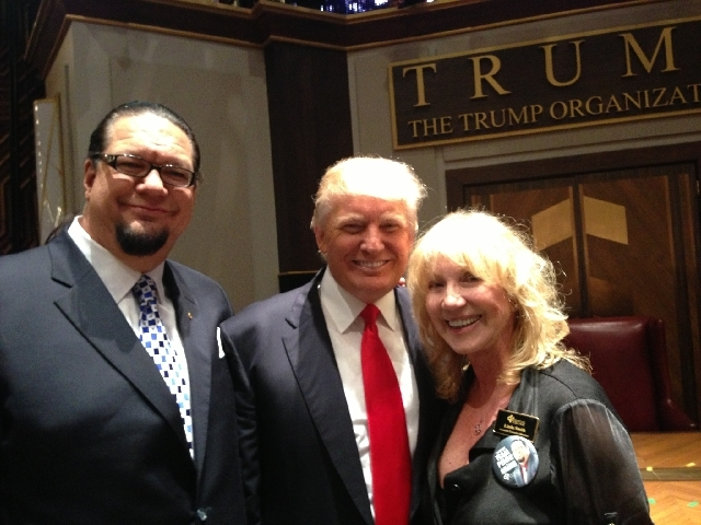 """""""All-Star Celebrity Apprentice"""" contestant Penn Jillette, left, is shown with billionaire Donald Trump and Opportunity Village Associate Executive Director Linda Smith on Sunday night in New York."""